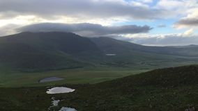 The Conor Pass, Ireland. The Conor Pass is the highest mountain pass in Ireland. It is situated on the Dingle Peninsula in County Kerry, on the road that crosses stock video footage