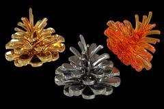 Conos coloreados del pino Fotografía de archivo libre de regalías