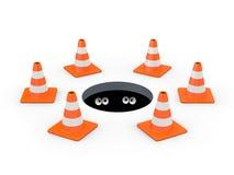 Conos del tráfico alrededor de una boca Foto de archivo libre de regalías