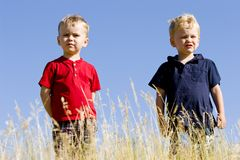 Conquer. Two boys conquer the world and stand at the top Royalty Free Stock Photo