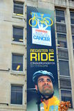 Conquer Cancer Ad. The Conquer Cancer Ride advertisement on a building in Toronto, Canada Royalty Free Stock Photo