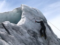 Conquer the Ice. Picture of a young woman ice climbing Stock Image