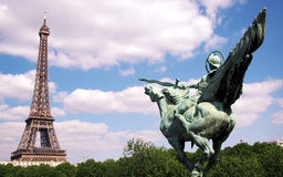 Conquer Paris. Let's conquer Paris! This funny and real photo shows the bronze statue of a horse rider with his sword pointing at the Eiffel Tower. This statue Royalty Free Stock Images