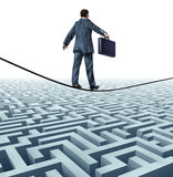 Conquering Adversity. And rising above a challenge as a businessman with a briefcase on a tightrope walking above a complex maze obstacle as an innovative risk vector illustration