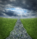 Conquering Adversity. And overcoming business challenges ahead with a bumpy highway path made of rough rocks leading into a perspective horizon with storm stock illustration