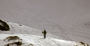 Conquering the mountain. Freeskier climbing the mountain for the best trail stock images