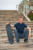 Conquering the steps with his board. Royalty Free Stock Image