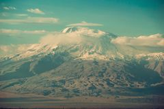 Conquest of peak, achievement concept. Impressive scenic mountain landscape. Big Ararat, Turkey. View point from Yerevan, Armenia. Snow-capped peak. Majestic Stock Photography