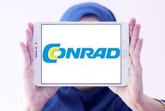 Conrad electronics retailer logo. Logo of Conrad electronics retailer on samsung tablet holded by arab muslim woman. Conrad is one of Europe`s leading Royalty Free Stock Images