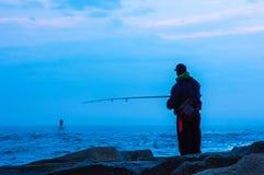 Consapevolezza ~ pescatore di crepuscolo Fotografia Stock Libera da Diritti