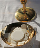 Consecrated Host during the Mass of first communion Stock Images