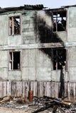 Consecuencias de un fuego en la casa imagen de archivo