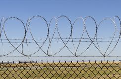 Razor Wire with Love. Consecutive heart shapes created by the razor wire at the airport fencing in Brisbane, Australia Stock Photography