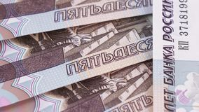 Consecutive numbers on rubles. Rotation of new banknotes of Russian rubles with the numbers in order stock video footage