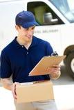 Consegna: Uomo con la consegna Van Behind Fotografie Stock