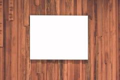 Conseil blanc sur le mur en bois Photos stock