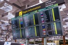 Conseil de départ dans l'aéroport international de Changi, Singapour Chang Photographie stock libre de droits