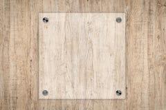 Conseil de verre ou cadre acrylique sur le fond en bois Images stock