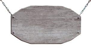 Conseil en bois vide accrochant sur des chaînes d'isolement sur le blanc photos stock