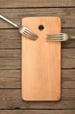 Conseil rayé et vieilles fourchettes Photo stock