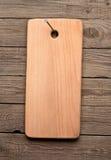 Conseil rayé sur une surface en bois Photos stock