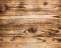Conseils en bois brûlés avec la texture de noeuds Photographie stock