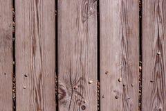 Conseils en bois gris avec des cailloux Photos stock