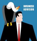 Consejero de negocio El buitre se sienta en el hombro del hombre de negocios Fotos de archivo