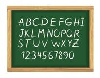 Consejo escolar con alfabeto de la tiza Imagen de archivo libre de regalías