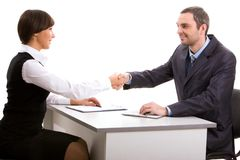 Consensus. Photo of businesspartners shaking hands after making an agreement and looking at each other Stock Photography