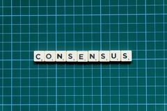 Consensus word made of square letter block on green square mat background.  stock image