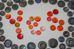 Always say yes!. Consent, positive response, approval. The red buttons include the word `yes`. Around there are many other black buttons for clothes. Active life Stock Photography