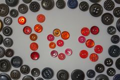 Consent, a positive response. The word `yes`, made up of red buttons. Initiative people, positive attitude, volunteers. Around the black buttons of different Stock Photo