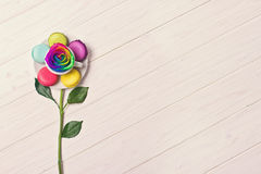 Consept image of cup of coffee, macaron and flower on white wooden background. Rainbow rose. Set of multicolored macarons Royalty Free Stock Photo