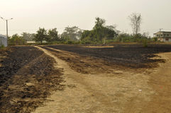 CONSEQUENCE OF BRASS LIGHTS. Sad face of an aficain village half destroyed by the bush fires probably light in the forest by the man to clear the land or to hunt stock images