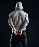 Consequence of Crime. Man arrested as a consequence of his crime stock photo