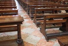 Consequence of the religious crisis are the empty Church pew ben. The consequence of the religious crisis are the empty Church pew bench with kneeler inside the stock image