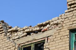 The consequence of the rocket rupture. Fragment of the wall of the house after a rocket strike royalty free stock images