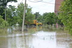 The consequences of flooding, house with truck stock photography