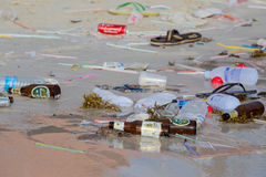 Consequences of sea water pollution on the beach after the full moon party. Island Koh Phangan, Thailand Stock Photos