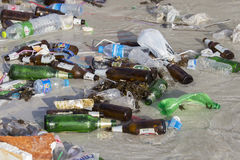 Consequences sea water pollution on the beach after full moon party in Thailand. Close up Stock Photo