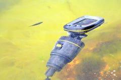 Consequences of shipwreck. Broken Navigator and fish Stock Photography