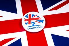 Conservatief Partijkenteken op de Britse Vlag stock afbeelding