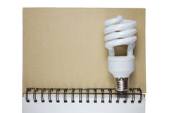 Conservation Energy. The light bulb on diary royalty free stock photo