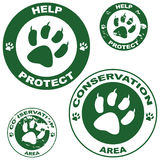Conservation stickers. Set of stickers with conservation theme and an animal paw outline stock illustration