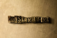 CONSERVATIVE - close-up of grungy vintage typeset word on metal backdrop. Royalty free stock illustration.  Can be used for online banner ads and direct mail Royalty Free Stock Photography