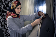 Conservative Fashion Designer with Hijab stock photos