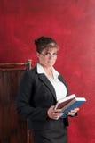 Conservative teacher. Conservative female teacher holding books royalty free stock images