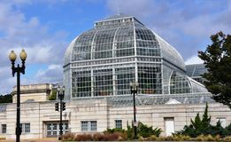Conservatory of a botanical garden. Stock Images