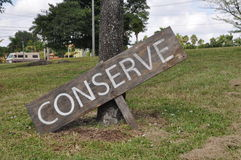 Conserve Sign. Wooden sign that says conserve stock photo